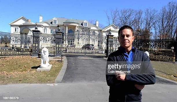 Dale Storey stands outside a multi million dollar home in Mississauga on March 29th 2013He is trying to bring attention to the growing disparity in...