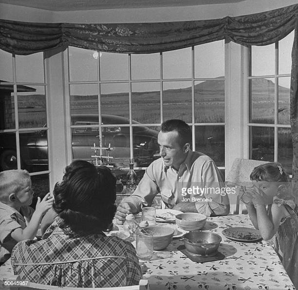 Dale Strout and family sharing a meal indoors