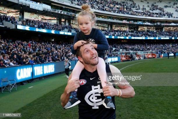 Dale Thomas of the Blues and daughter Matilda celebrate after the round 22 AFL match between the Carlton Blues and the St Kilda Saints at Marvel...