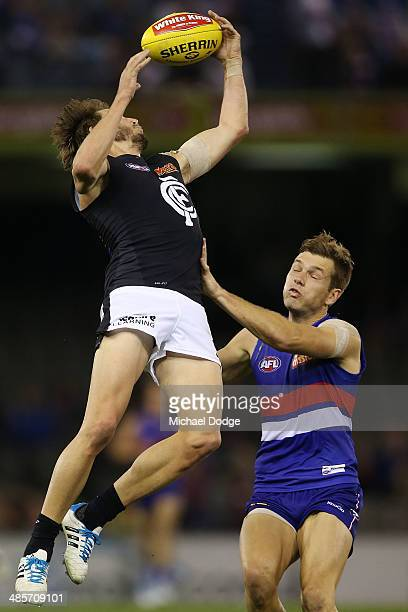 Dale Thomas of the Blues and Shaun Higgins of the Bulldogs contest for the ball during the round five AFL match between the Western Bulldogs and the...