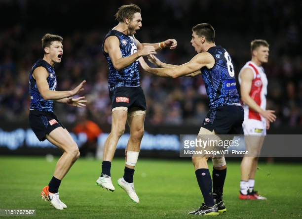 Dale Thomas of the Blues celebrates a goal by Matthew Kreuzer of the Blues during the round 10 AFL match between the St Kilda Saints and the Carlton...
