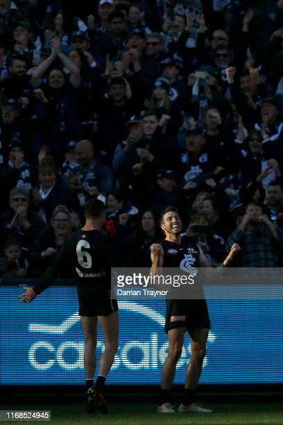 Dale Thomas of the Blues celebrates as the final siren sound in his last home game for Carlton during the round 22 AFL match between the Carlton...
