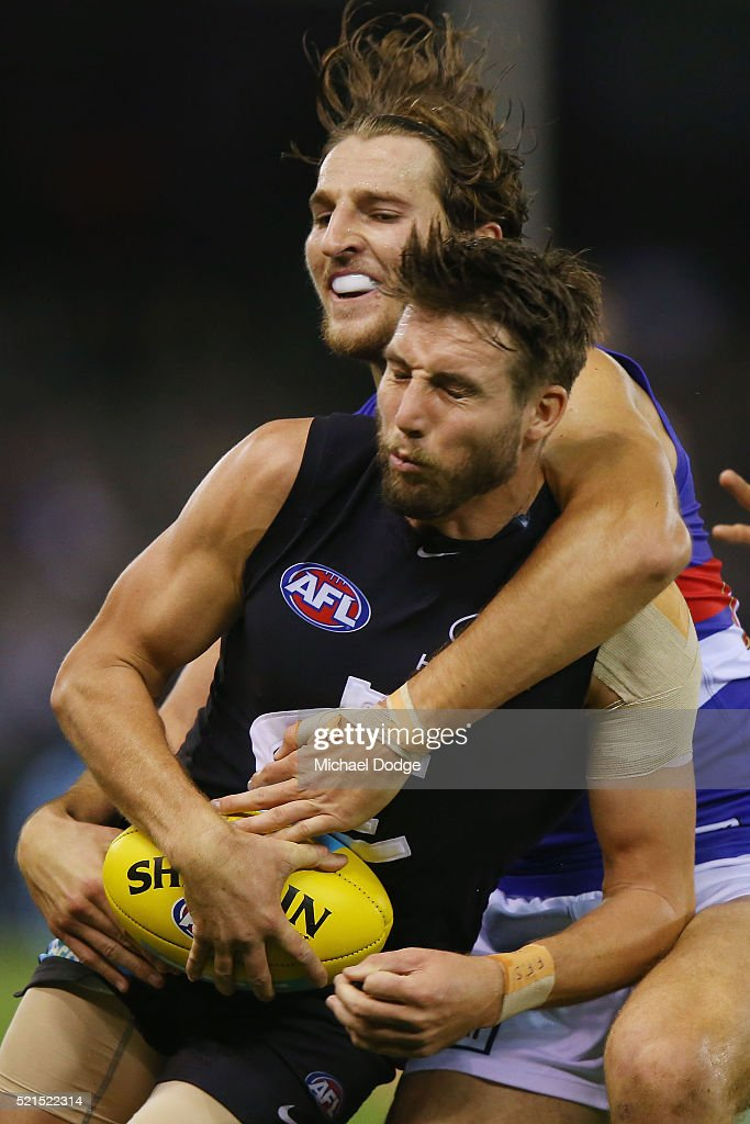 Dale Thomas of the Blues is tackled by Marcus Bontempelli of the Bulldogs during AFL Round 4 match between the Carlton Blues and the Western Bulldogs at Etihad Stadium on April 16, 2016 in Melbourne, Australia.