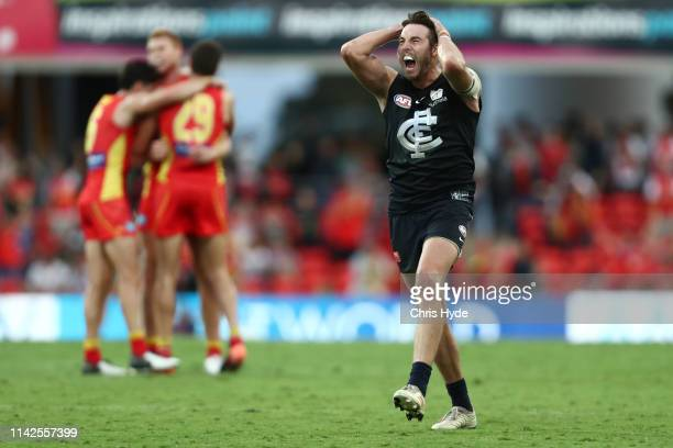 Dale Thomas of the Blues reacts after losing the round four AFL match between the Gold Coast Suns and the Carlton Blues at Metricon Stadium on April...