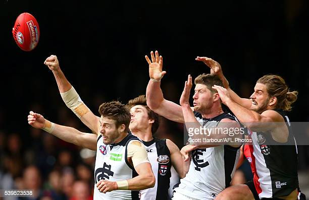 Dale Thomas of the Blues Sam Rowe of the Blues and Josh Bruce of the Saints compete for the ball during the round 12 AFL match between the St Kilda...