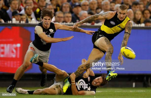 Dale Thomas of the Blues tackles Dustin Martin of the Tigers during the 2018 AFL round 01 match between the Richmond Tigers and the Carlton Blues at...