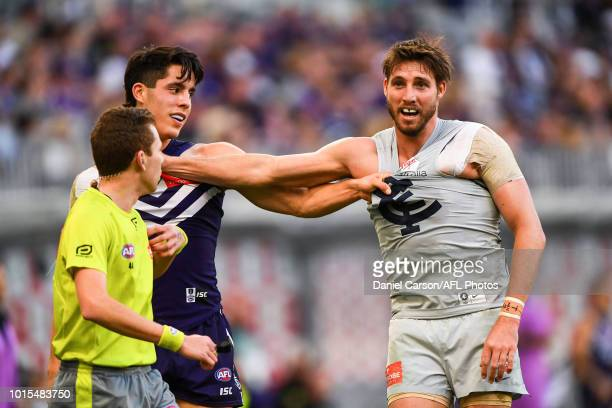 Dale Thomas of the Blues wrestles with Adam Cerra of the Dockers during the 2018 AFL round 21 match between the Fremantle Dockers and the Carlton...