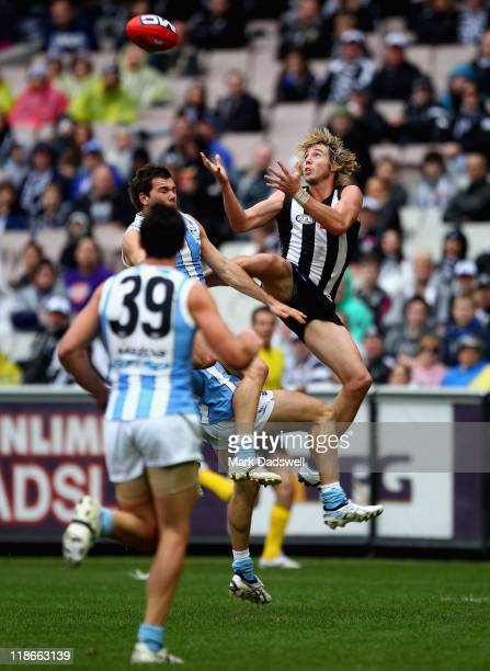 Dale Thomas of the Magpies flies for a mark during the round 16 AFL match between the Collingwood Mgapies and the North Melbourne Kangaroos at...