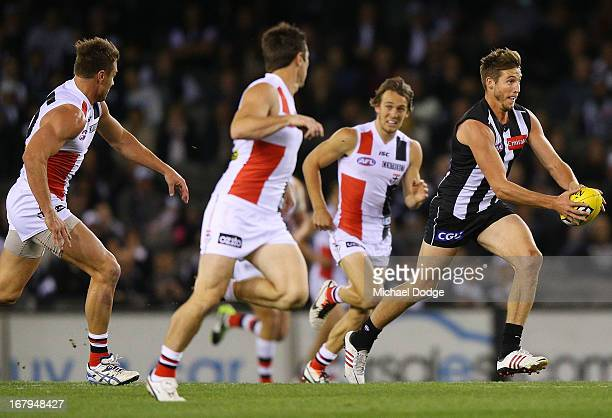 Dale Thomas of the Magpies runs with the ball during the round six AFL match between the Collingwood Magpies and the St Kilda Saints at Etihad...