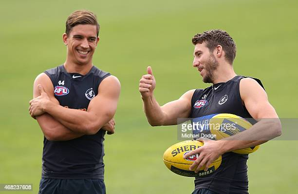 Dale Thomas reacts next to Andrew Carrazzo during a Carlton Blues AFL training session at Ikon Park on April 1 2015 in Melbourne Australia