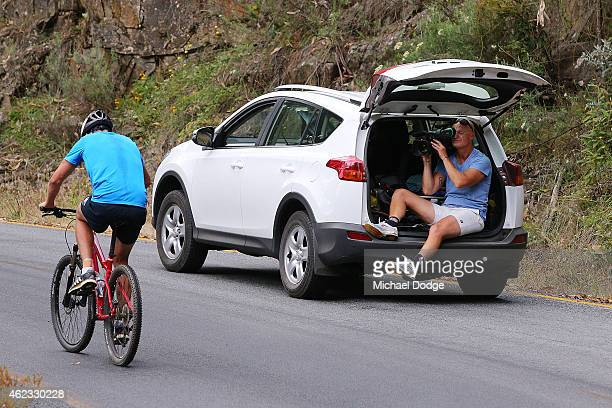 Dale Thomas rides up Mount Buller with a camera man filming him during the Carlton Blues AFL training camp on January 27 2015 in Mount Buller...