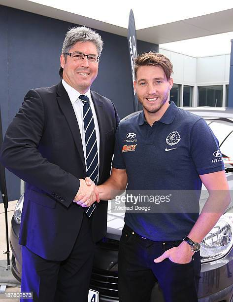 Dale Thomas shakes hands with president Stephen Kernahan during a Carlton Blues AFL media opportunity at Visy Park on November 13, 2013 in Melbourne,...