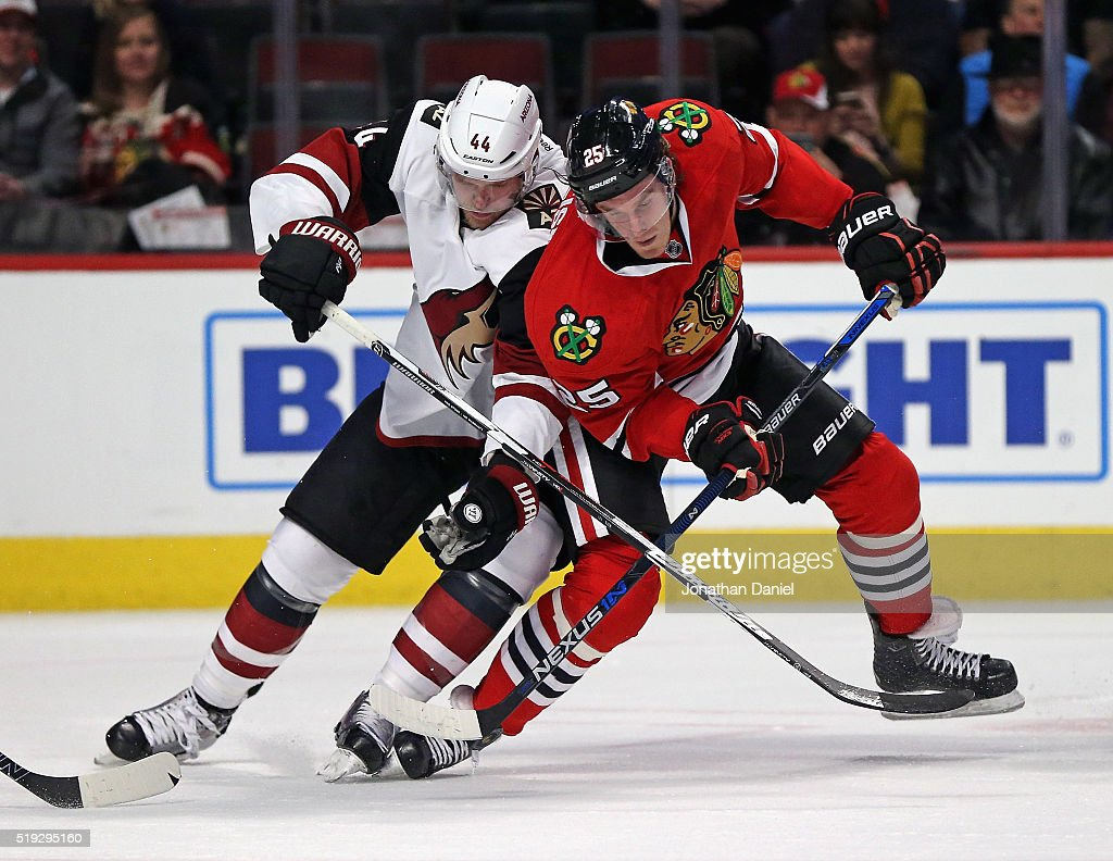 Dale Weise #25 of the Chicago Blackhawks and Kevin Connauton #44 of the Arizona Coyotes battle for the puck at the United Center on April 5, 2016 in Chicago, Illinois. The Blackhawks defeated the Coyotes 6-2.
