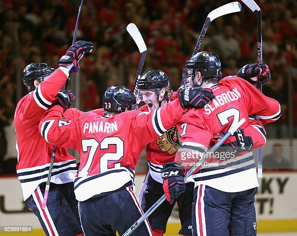 Dale Weise of the Chicago Blackhawks celebrates a second period goal with teammates including Artemi Panarin and Brent Seabrook against the St Louis...