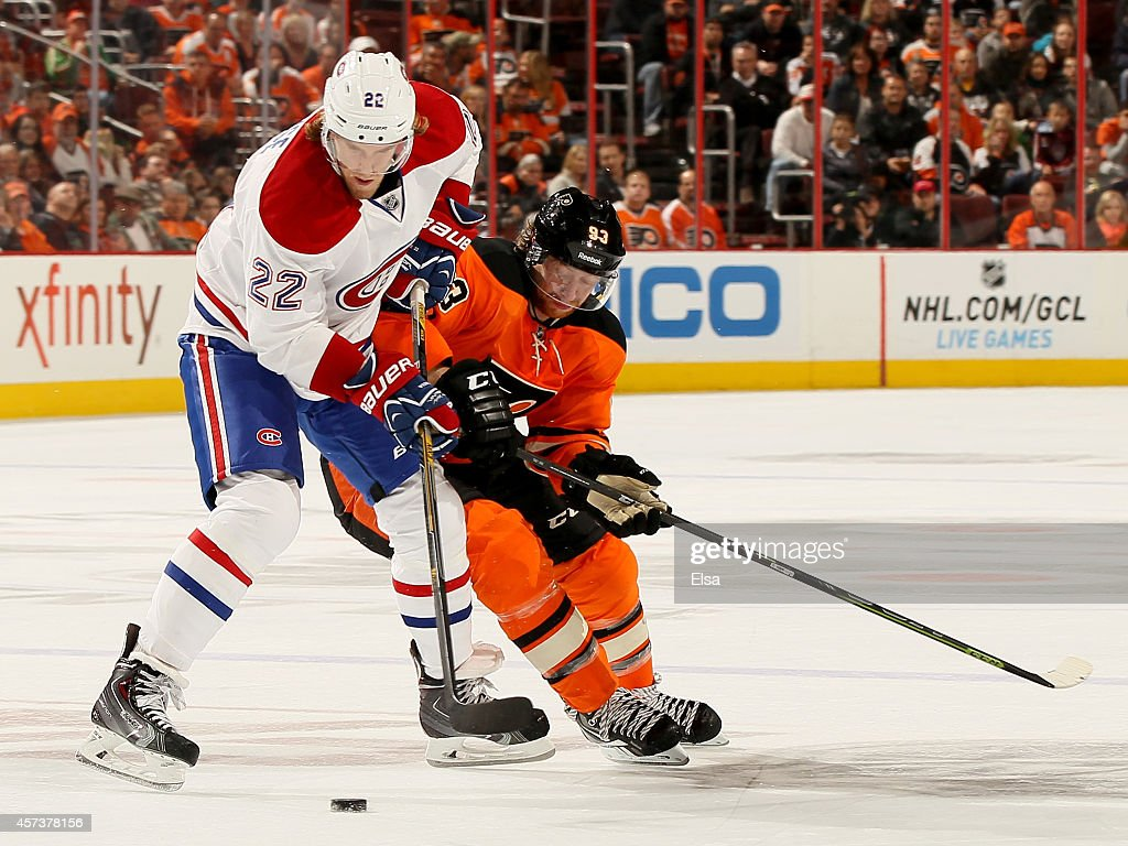 Dale Weise #22 of the Montreal Canadiens and Jakub Voracek #93 of the Philadelphia Flyers fight for the puck on October 11, 2014 at the Wells Fargo Center in Philadelphia, Pennsylvania.The Montreal Canadiens defeated the Philadelphia Flyers 4-3 in an overtime shootout.