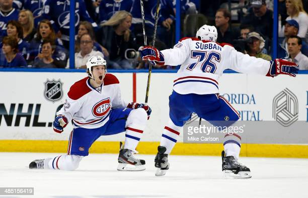 Dale Weise of the Montreal Canadiens celebrates his game-winning goal in overtime with P.K. Subban against the Tampa Bay Lightning in Game One of the...