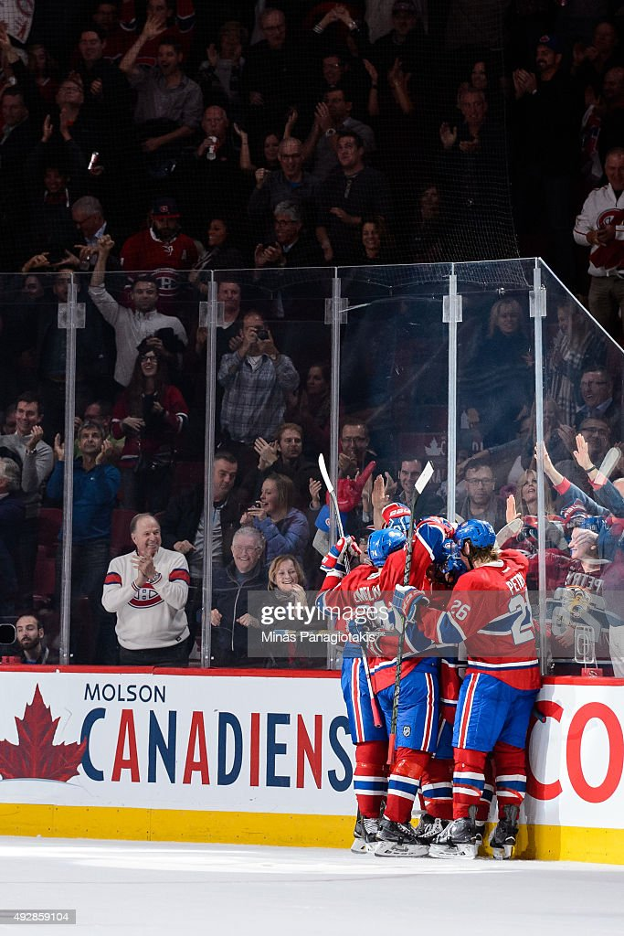 Dale Weise #22 of the Montreal Canadiens celebrates his third period goal with teammates during the NHL game against the New York Rangers at the Bell Centre on October 15, 2015 in Montreal, Quebec, Canada. The Canadiens defeated the Rangers 3-0 and for the first time in franchise history, the Canadiens have won five games in a row to start the season.