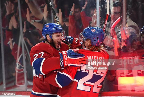 Dale Weise of the Montreal Canadiens celebrates with Alex Galchenyuk after scoring a goal against the Philadelphia Flyers in the NHL game at the Bell...