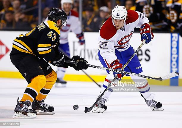 Dale Weise of the Montreal Canadiens fights for the puck against Matt Bartkowski of the Boston Bruins in the first overtime period in Game One of the...
