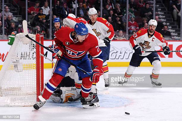 Dale Weise of the Montreal Canadiens watches the rebounding puck in front of Roberto Luongo and Aleksander Barkov of the Florida Panthers during the...