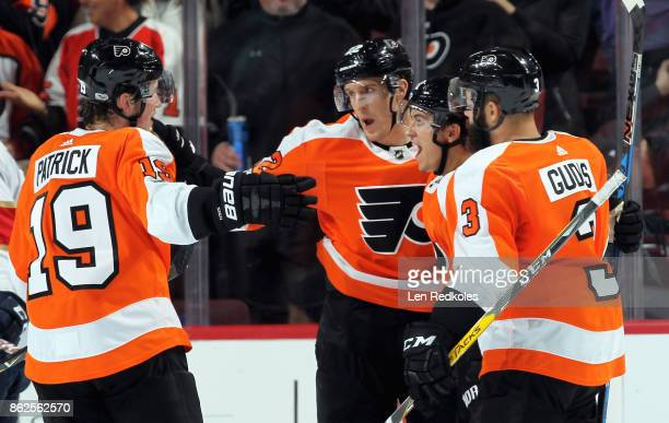 Dale Weise of the Philadelphia Flyers celebrates his second period goal against the Florida Panthers with teammates Nolan Patrick Travis Konecny and...