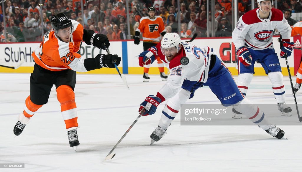 Dale Weise #22 of the Philadelphia Flyers shoots the puck against Jeff Petry #26 of the Montreal Canadiens on February 20, 2018 at the Wells Fargo Center in Philadelphia, Pennsylvania. The Flyers went on to defeat the Canadiens 3-2 in overtime.
