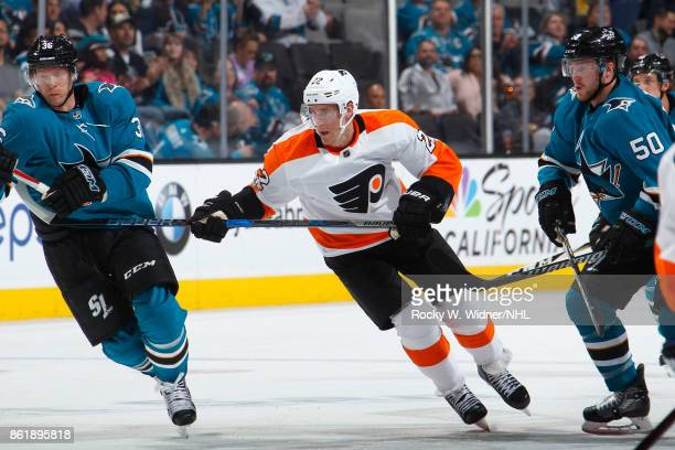 Dale Weise of the Philadelphia Flyers skates against Jannik Hansen of the San Jose Sharks at SAP Center at San Jose on October 4 2017 in San Jose...