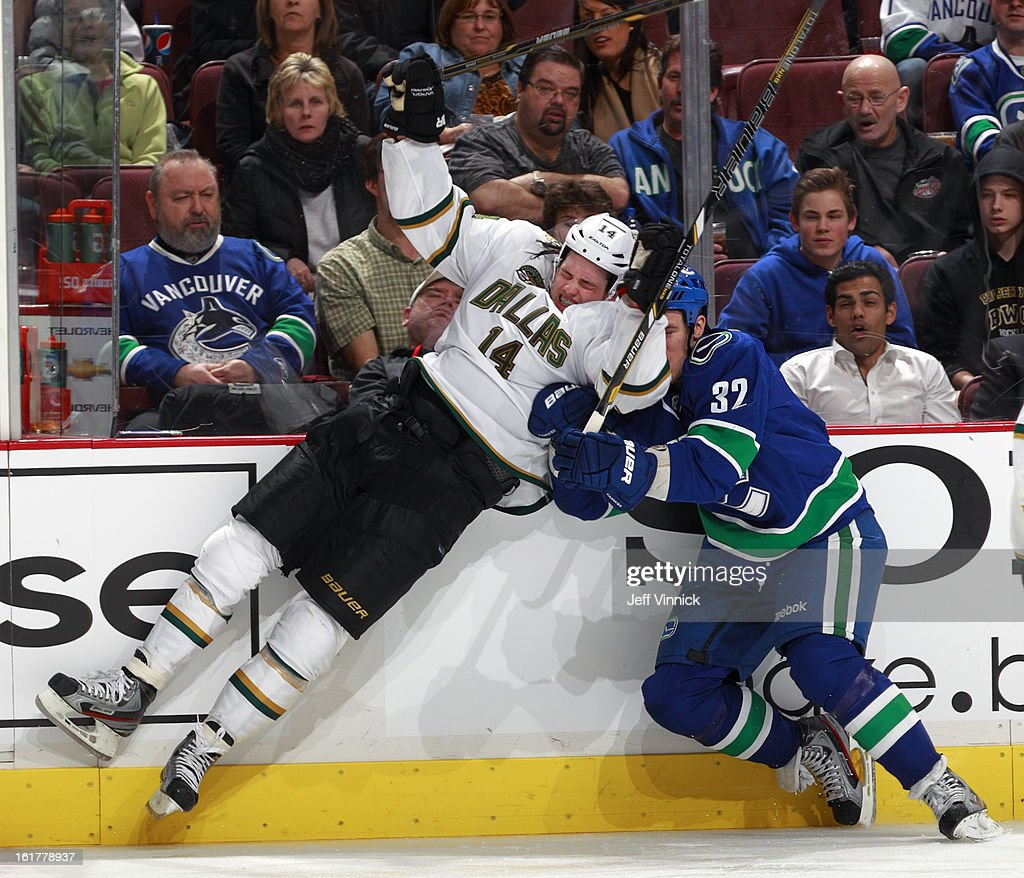 Dale Weise #32 of the Vancouver Canucks and Jamie Benn #14 of the Dallas Stars collide during their NHL game at Rogers Arena February 15, 2013 in Vancouver, British Columbia, Canada. Dallas won 4-3.