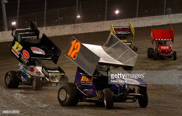 Dale Wester driver of ASCS sprint car leads Harli White driver of ASCS sprint car out of turn two during the PortACool US National Dirt Track...