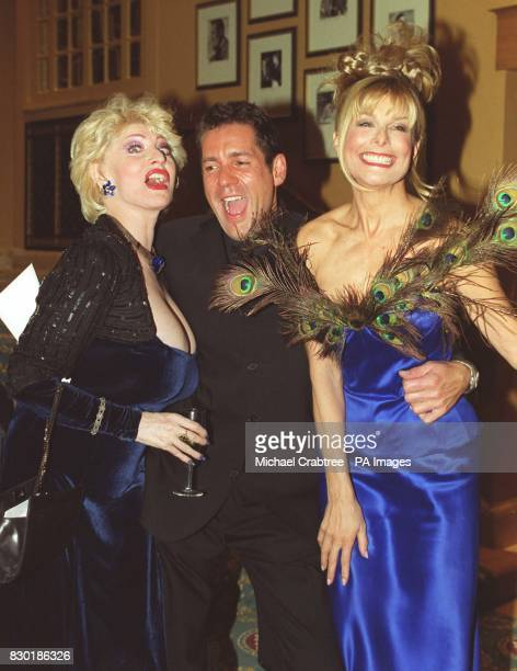 Dale Winton appears to have his hands full while in the company of Faith Brown and Jilly Johnson when they attending a star studden celebrity fashion...