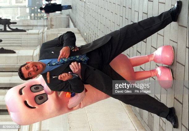 Dale Winton with Mr Sausage outside the New Connaught Rooms in London where he was hosting the British Sausage Appreciation Society's Regional...