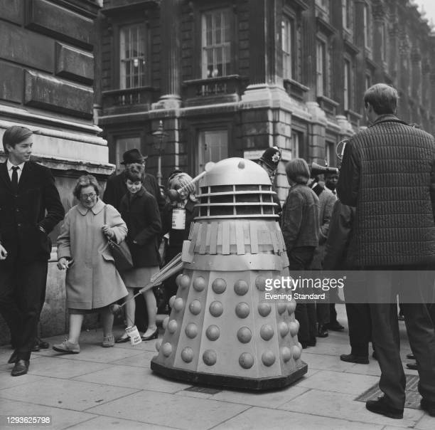 Dalek from the British television science fiction show 'Doctor Who' collects donations for a cancer research charity on Downing Street in London, UK,...
