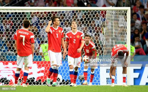 Daler Kuziaev Ilya Kutepov Mario Fernandes Fedor Smolov and Aleksandr Erokhin of Russia walk away dejected after the second Croatia goal scored by...