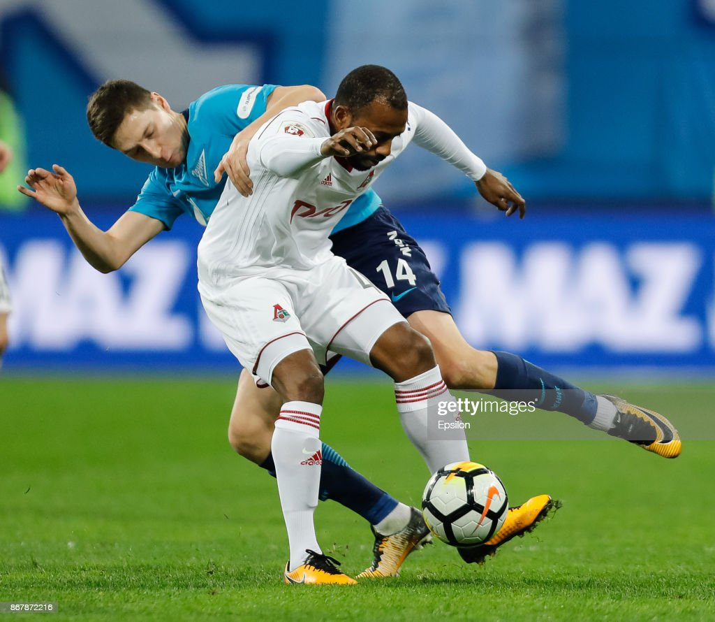 Daler Kuzyaev of FC Zenit Saint Petersburg and Manuel Fernandes (in front) of FC Lokomotiv Moscow vie for the ball during the Russian Football League match between FC Zenit St. Petersburg and FC Lokomotiv Moscow on October 29, 2017 at Saint Petersburg Stadium in Saint Petersburg, Russia.