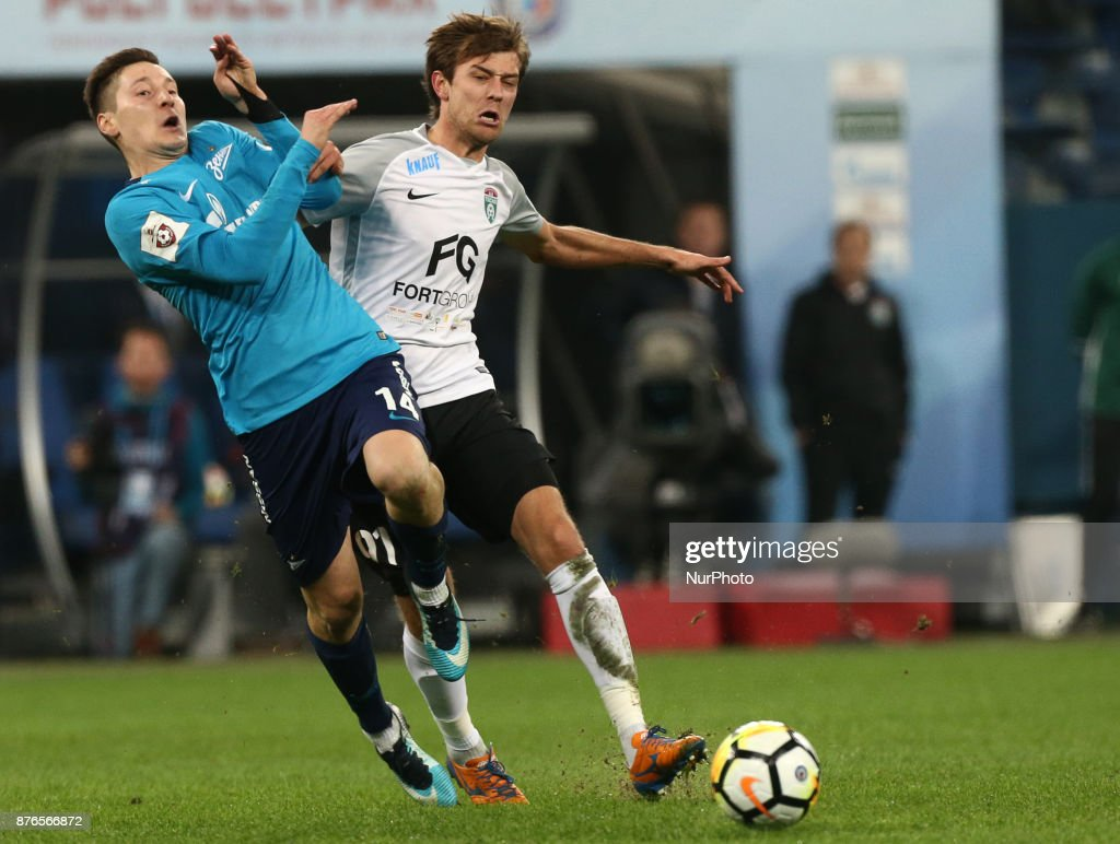 Daler Kuzyaev (L) of FC Zenit Saint Petersburg and Yan Kazaev of FC Tosno vie for the ball during the Russian Football League match between FC Zenit Saint Petersburg and FC Tosno at Saint Petersburg Stadium on November 19, 2017 in St. Petersburg, Russia.