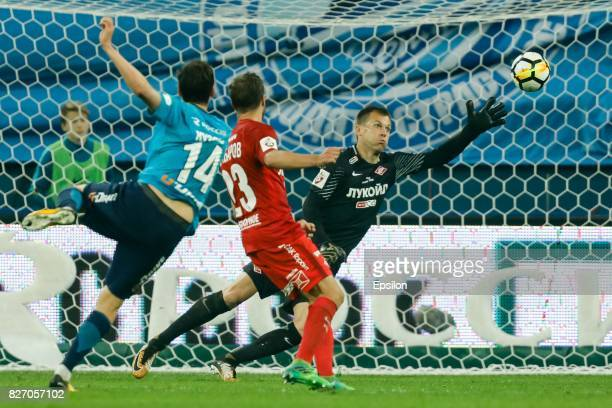 Daler Kuzyaev of FC Zenit Saint Petersburg scores a goal past Artyom Rebrov of FC Spartak Moscow during the Russian Football League match between FC...