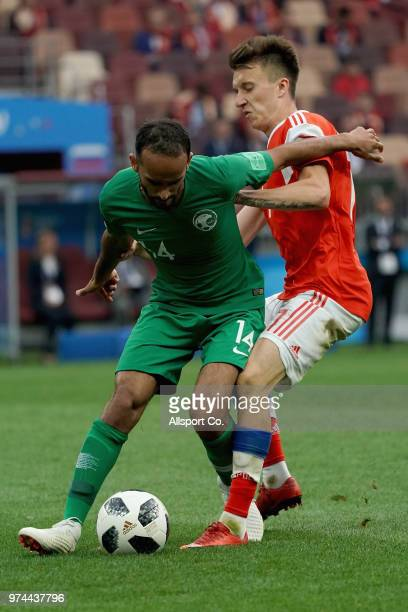 Daler Kuzyaev of Russia clashes with Abdullah Otayf of Saudi Arabia during the 2018 FIFA World Cup Russia group A match between Russia and Saudi...