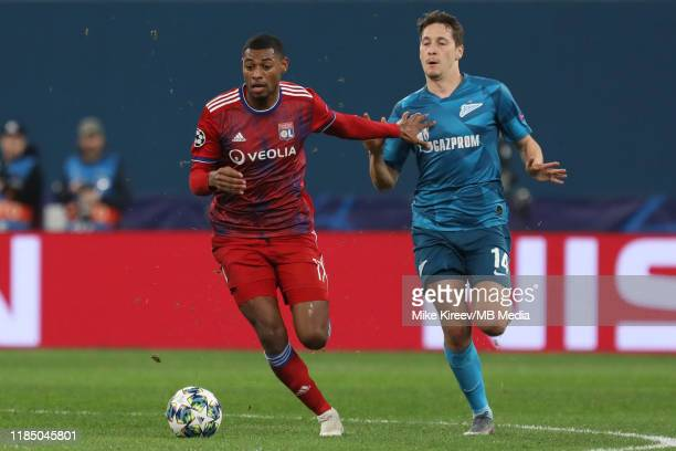 Daler Kuzyaev of Zenit and Jeff Reine-Adelaide of Lyon vie for the ball during the UEFA Champions League group G match between Zenit St. Petersburg...