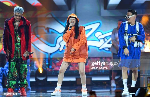 Dalex Cazzu and Lenny Tavares on stage during Premios Juventud 2019 at Watsco Center on July 18 2019 in Coral Gables Florida