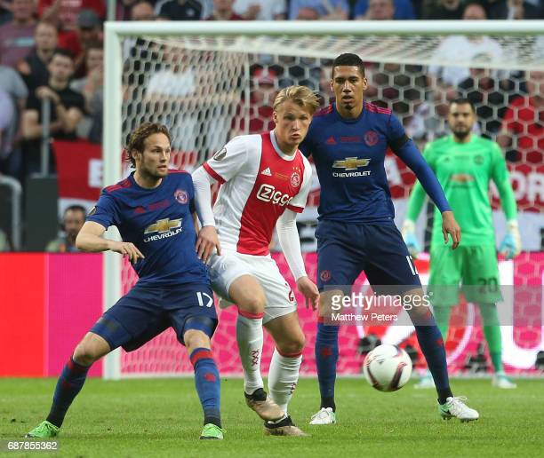 Daley Blind and Chris Smalling of Manchester United in action with Kasper Dolberg of Ajax during the UEFA Europa League Final match between...