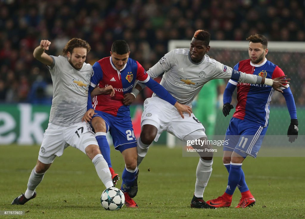 Daley Blind and Paul Pogba of Manchester United in action with Mohamed Elyounoussi and Renato Steffen of FC Basel during the UEFA Champions League group A match between FC Basel and Manchester United at St. Jakob-Park on November 22, 2017 in Basel, Switzerland.