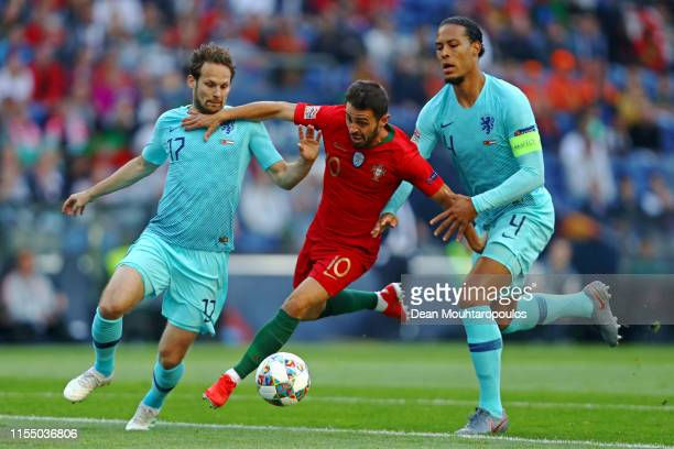 Daley Blind and Virgil van Dijk of The Netherlands battle for the ball with Bernardo Silva of Portugal during the UEFA Nations League Final between...
