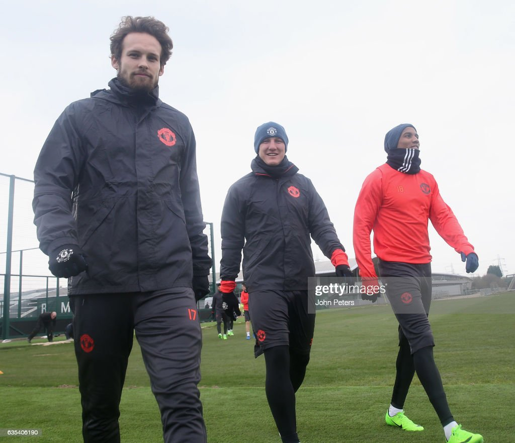 Daley Blind, Bastian Schweinsteiger and Ashley Young of Manchester United in action during a first team training session at Aon Training Complex on February 15, 2017 in Manchester, England.