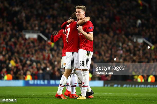Daley Blind celebrates scoring a penalty his side's second goal with Scott McTominay of Manchester United during the UEFA Champions League group A...