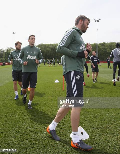 Daley Blind Matteo Darmian and Michael Carrick of Manchester United in action during a first team training session at Aon Training Complex on May 12...