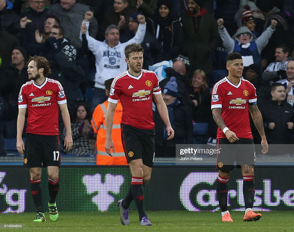 Daley Blind, Michael Carrick and Marcos Rojo of Manchester United react to Salomon Rondon of West Bromwich Albion scoring their first goal during the Barclays Premier League match between West Bromwich Albion and Manchester United at The Hawthorns on March 6, 2016 in West Bromwich, England.