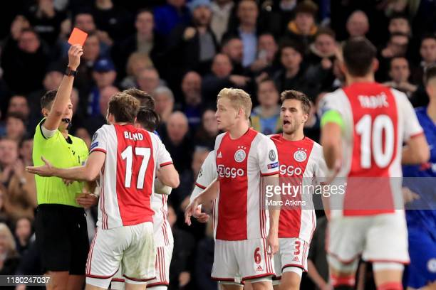 Daley Blind of AFC Ajax is shown a red card during the UEFA Champions League group H match between Chelsea FC and AFC Ajax at Stamford Bridge on...