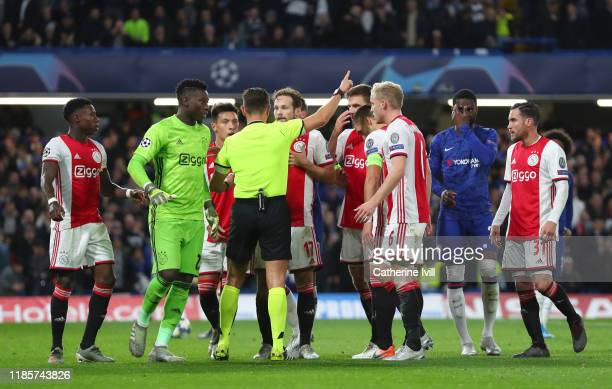 Daley Blind of AFC Ajax receives a second yellow and a red card from referee Gianluca Rocchi during the UEFA Champions League group H match between...