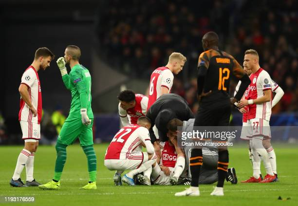 Daley Blind of AFC Ajax treated by medical team during the UEFA Champions League group H match between AFC Ajax and Valencia CF at Amsterdam Arena on...