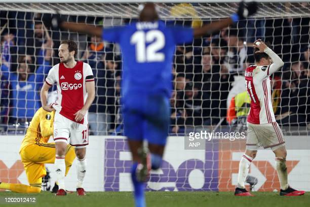 Daley Blind of Ajax Allan Nyom of Getafe CF Nico Tagliafico of Ajax during the UEFA Europa League round of 32 first leg match between Getafe CF and...